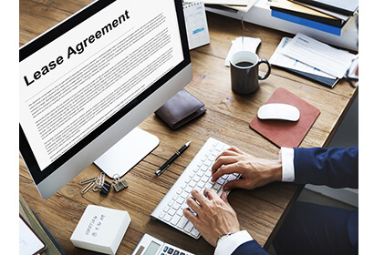 Lease agreement made simple, a man is typing on his computer