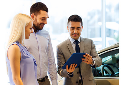Automotive car sales agent showing a loan to lessee