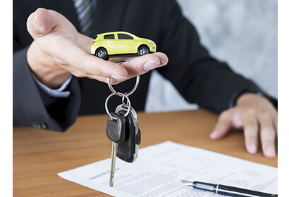 Signing a lease contract for a Car, with Keys to your dream Vehicle
